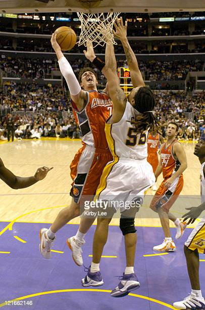 Primoz Brezec of the Charlotte Bobcats shoots over Brian Grant of the Los Angeles Lakers during the NBA game between the Los Angeles Lakers and the...