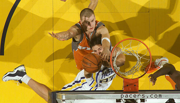 Phoenix suns v indiana pacers primoz brezec 27 of the indiana pacers battles maciej lampe 30 of the phoenix voltagebd Images
