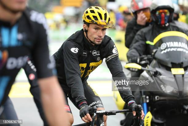 Primoz Roglic of Slovenia and Jumbo - Visma crosses the finish line during stage 8 of the 108th Tour de France 2021, a stage of 151 km between...