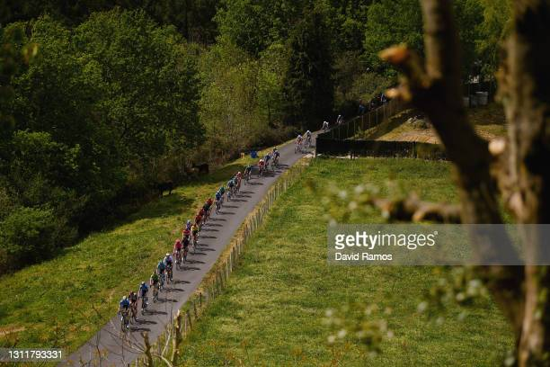 Primoz Roglic of Slovenia and Team Jumbo - Visma Green Points Jersey, Brandon Mcnulty of United States and UAE Team Emirates Yellow Leader Jersey &...