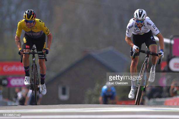 Primoz Roglic of Slovenia and Team Jumbo - Visma & Julian Alaphilippe of France and Team Deceuninck - Quick-Step sprint on arrival during the 85th La...