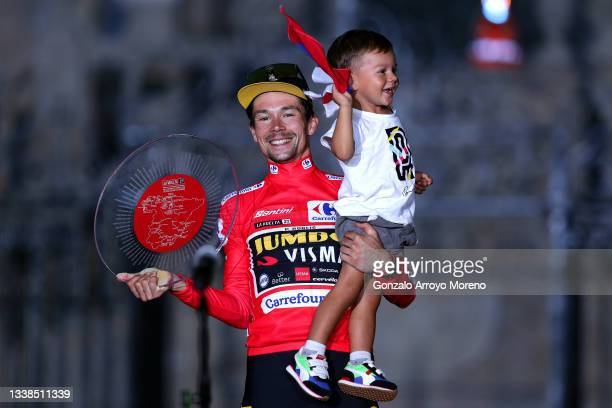 Primoz Roglic of Slovenia and Team Jumbo - Visma with his son Levom celebrate winning the red leader jersey on the podium ceremony in the Plaza del...