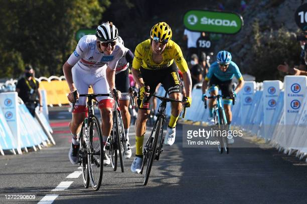 Primoz Roglic of Slovenia and Team Jumbo - Visma Yellow Leader Jersey / Tadej Pogacar of Slovenia and UAE Team Emirates White Best Young Rider Jersey...