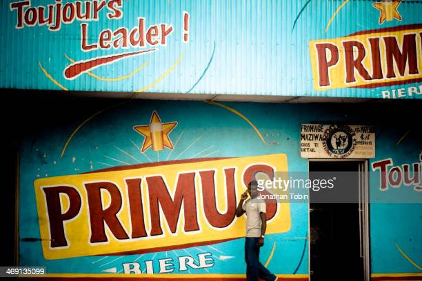 CONTENT] Primus national beer of the Democratic Republic of Congo This is and advertisement for Primus beer on the side of a building