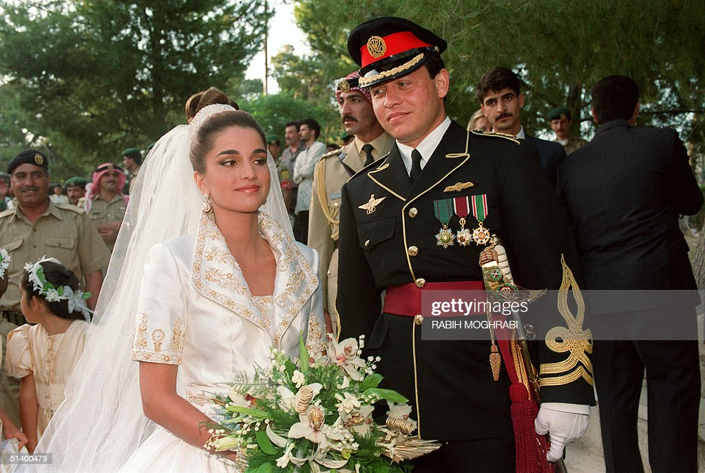 Prince Abdallah (Abdullah), the eldest son of Jordan's King Hussein, poses with his bride Rania Yassine, 28, after their wedding ceremony at the Royal Palace in Amman 10 June 1993. Prince Abdallah ascended the throne on the death of his father King Hussein 07 February 1999. His wife was officially designated Queen Rania 21 March 1999, at the end of the palace's three-month mourning period.