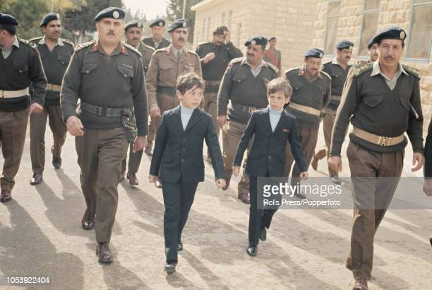 Prince Abdullah and his brother Prince Faisal bin Hussein of Jordan pictured with senior Jordanian Army officers as they attend artillery manoeuvres...