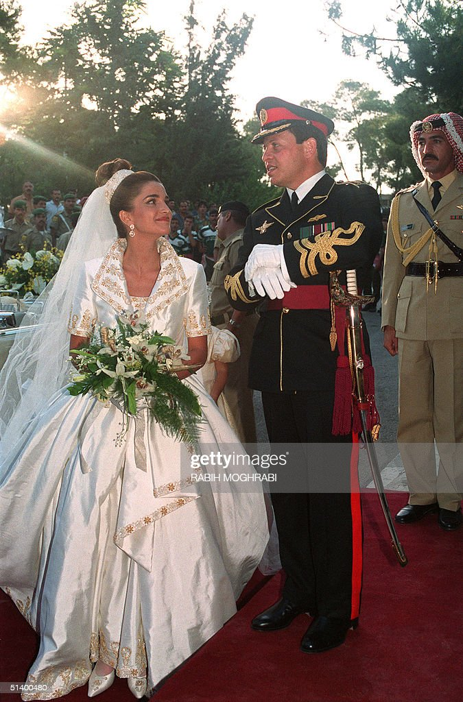 Prince Abdullah, the eldest son of Jordan's King Hussein, poses with his bride Rania Yassine, 28, after their wedding ceremony at the Royal Palace in Amman 10 June 1993. Prince Abdallah ascended the throne on the death of his father King Hussein 07 February 1999. His wife was officially designated Queen Rania 21 March 1999, at the end of the palace's three-month mourning period.