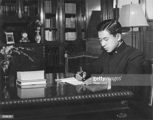 Prince Akihito of Japan who became Emperor in 1989 in his private study at the Imperial Palace Tokyo 1952