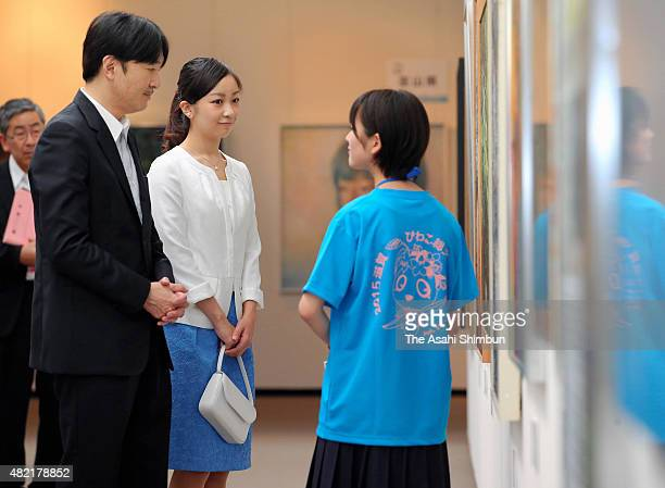 Prince Akishino and his second daughter Princess Kako watch exhibits during the InterHigh School Cultural Festival at Shiga Prefecture Museum of...