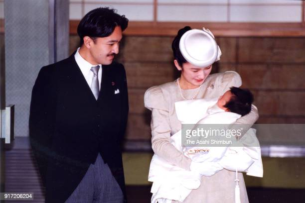 Prince Akishino and Princess Kiko holding her daughter Princess Mako are seen after their meeting with Emperor Akihito and Empress Michiko following...