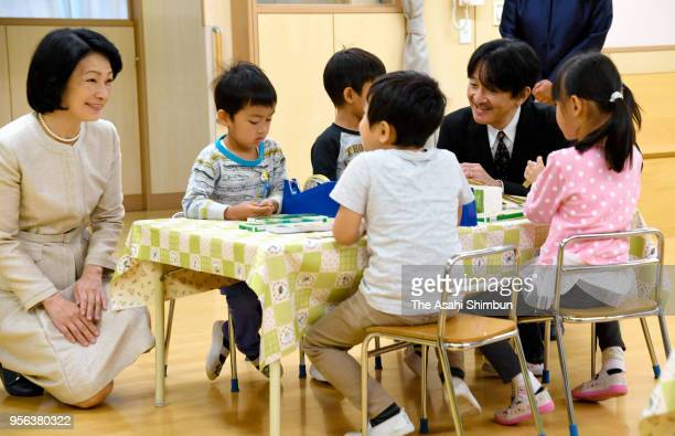 Prince Akishino and Princess Kiko of Akishino talk with children during their visit to the Shinjuku Kodomo En Nursery school on May 9 2018 in Tokyo...