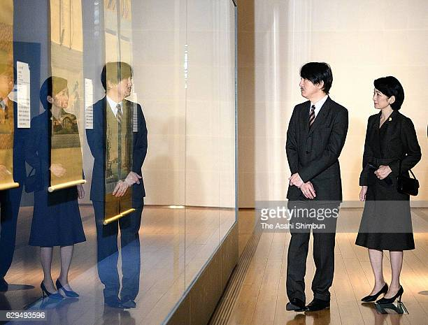 Prince Akishino and Princess Kiko of Akishino watch artworks at the 'Seven Daring Years Odano Naotake and Akita Ranga' exhibition at Suntory Museum...