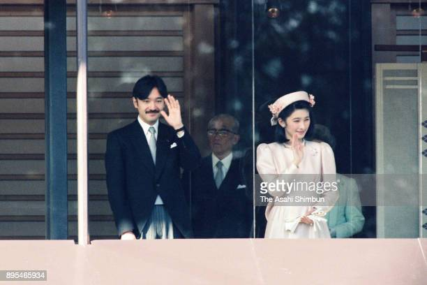 Prince Akishino and Princess Kiko of Akishino wave to wellwishers on Emperor Akihito's 60th birthday at the Imperial Palace on December 23 1993 in...