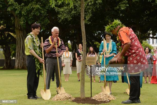 Prince Akishino of Japan Honolulu Mayor Kirk Caldwell and Princess Kiko of Japan plant a tree at Thomas Square Park in Honolulu Hawaii on June 5...