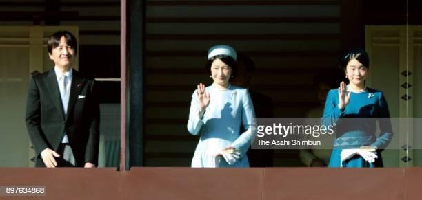 Prince Akishino Princess Kiko and Princess Mako of Akishino wave to wellwishers during a session celebrating Emperor Akihito's 84th birthday at the...