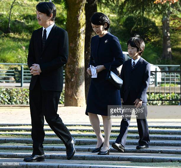 Prince Akishino Princess Kiko and their son Prince Hisahito leave after offering flowers at the Abomb Hypocenter Memorial at Nagasaki Hypocenter Park...