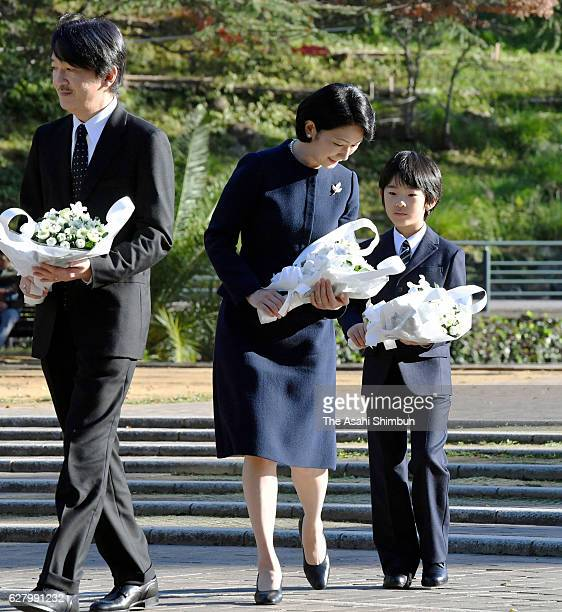 Prince Akishino Princess Kiko and their son Prince Hisahito walk to offer flowers at the Abomb Hypocenter Memorial at Nagasaki Hypocenter Park on...