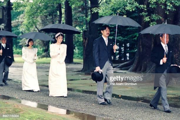 Prince Akishino, Princess Kiko of Akishino, Princess Sayako and Prince Hitachi walk to the Kashikodokoro prior to the royal wedding at the Imperial...