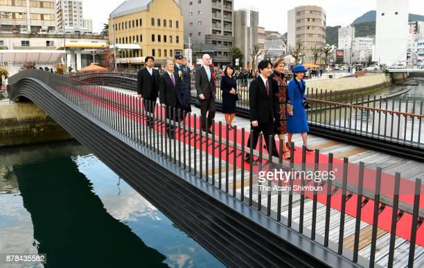 Prince Akishino Princess Laurentien of the Netherlands and Princess Kiko of Akishino cross the new main gate to 'Dejima' on November 24 2017 in...