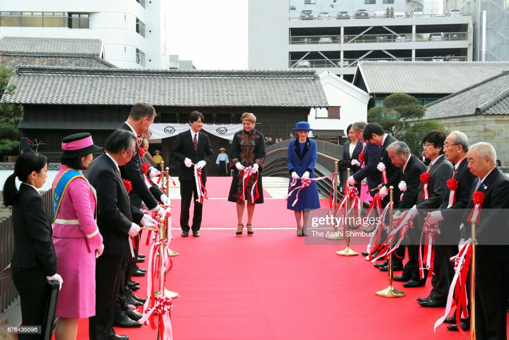 Prince Akishino, Princess Laurentien of the Netherlands and Princess Kiko of Akishino attend the tape-cutting ceremony of the new main gate to 'Dejima' on November 24, 2017 in Nagasaki, Japan. The Dejima artificial island was built during the Edo era, where Dutch merchants were allowed to trade with Japan.