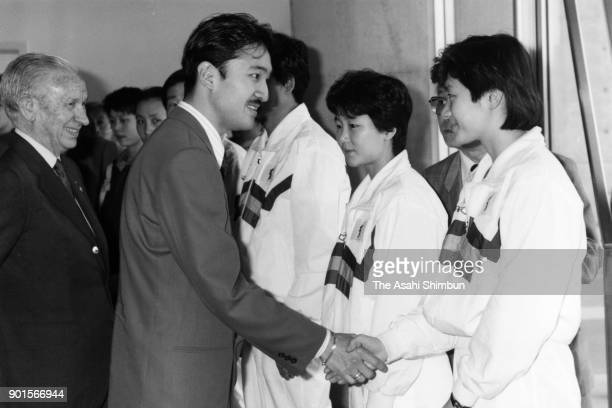 Prince Akishino shakes hands with players of Korea Unified Team prior to the closing ceremony during the World Table Tennis Championships at Makuhari...