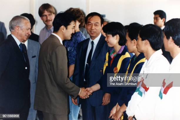Prince Akishino shakes hands with players prior to the closing ceremony during the World Table Tennis Championships at Makuhari Messe on May 6 1991...