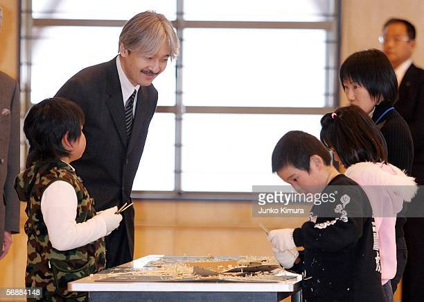 Prince Akishino the second son of the Emperor Akihito watches students making a traditional Japanese toy 'Taketonbo'out of Bamboo at Hotakane...