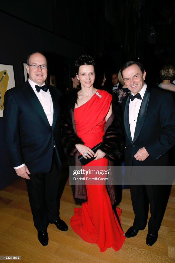 Prince Albert de Monaco, Actress Juliette Binoche and President of Cartier Stanislas de Quercize attend the 'Cartier: Le Style et L'Histoire' Exhibition Private Opening at Le Grand Palais on December 2, 2013 in Paris, France.