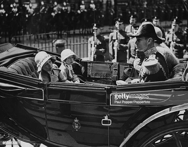 Prince Albert Duke of York and Lady Elizabeth BowesLyon and their daughters Princesses Elizabeth and Margaret sit together in an open carriage as...