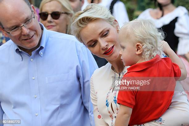Prince Albert II and his wife Princess Charlene of Monaco arrive with Prince Jacques the heir apparent to the Monegasque throne to take part in the...