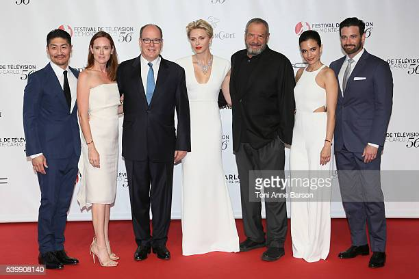 Prince Albert II and HSH Princess Charlene pose with Dick Wolf Torrey DeVitto Brian Tee and cast at the 56th Monte Carlo TV Festival Opening Ceremony...