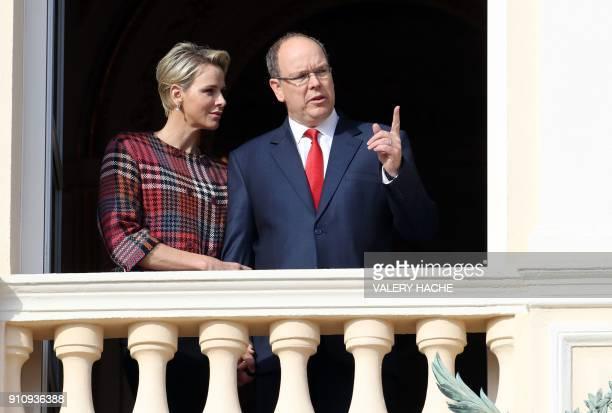 Prince Albert II and Princess Charlene of Monaco appear on the palace's balcony during Sainte Devote Celebrations in Monaco on January 27 2018 Saint...