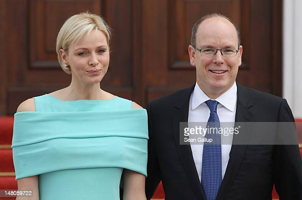Prince Albert II and Princess Charlene of Monaco arrive at Schloss Bellevue Palace on July 9 2012 in Berlin Germany Prince Albert II and Princess...