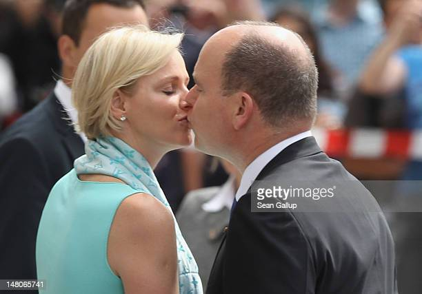 Prince Albert II and Princess Charlene of Monaco kiss while visiting the Brandenburg Gate on July 9 2012 in Berlin Germany Prince Albert II and...