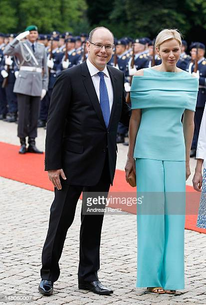 Prince Albert II and Princess Charlene of Monaco smile upon their arrival at Schloss Bellevue Palace on July 9 2012 in Berlin Germany Prince Albert...