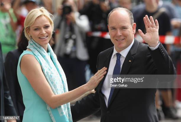Prince Albert II and Princess Charlene of Monaco wave to onlookers while visiting the Brandenburg Gate on July 9 2012 in Berlin Germany Prince Albert...