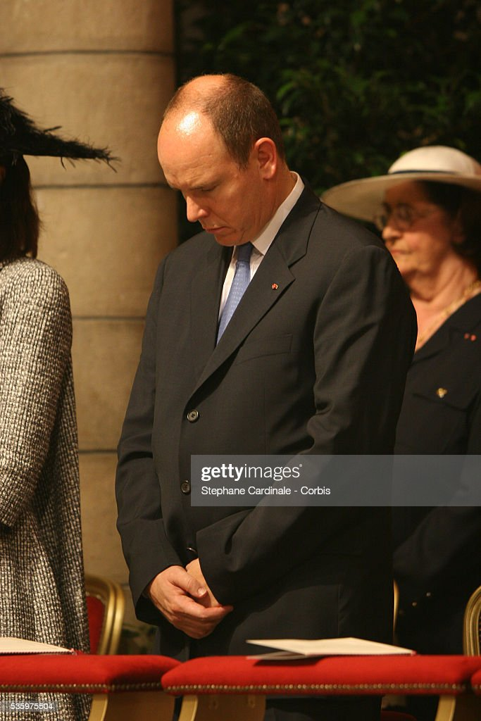 Prince Albert II bows his head during his enthronement mass in Monaco Cathedral. Prince Albert II, 47, took over as ruler of the principality following the death of his father, Prince Rainier in April.
