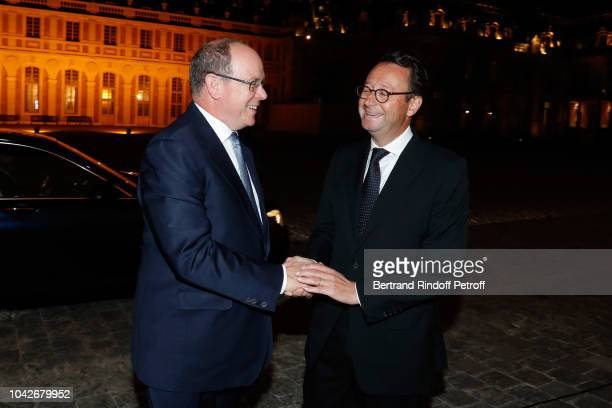 Prince Albert II de Monaco and Chairman of the 2018 Ryder Cup France Commission Pascal Grizot attend the Ryder Cup Dinner at Chateau de Versailles on...