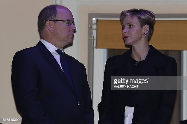 Prince Albert II de Monaco and Princess Charlene of Monaco appear on the balcony of the prince's palace to celebrate Good Friday on March 25 2016 in...