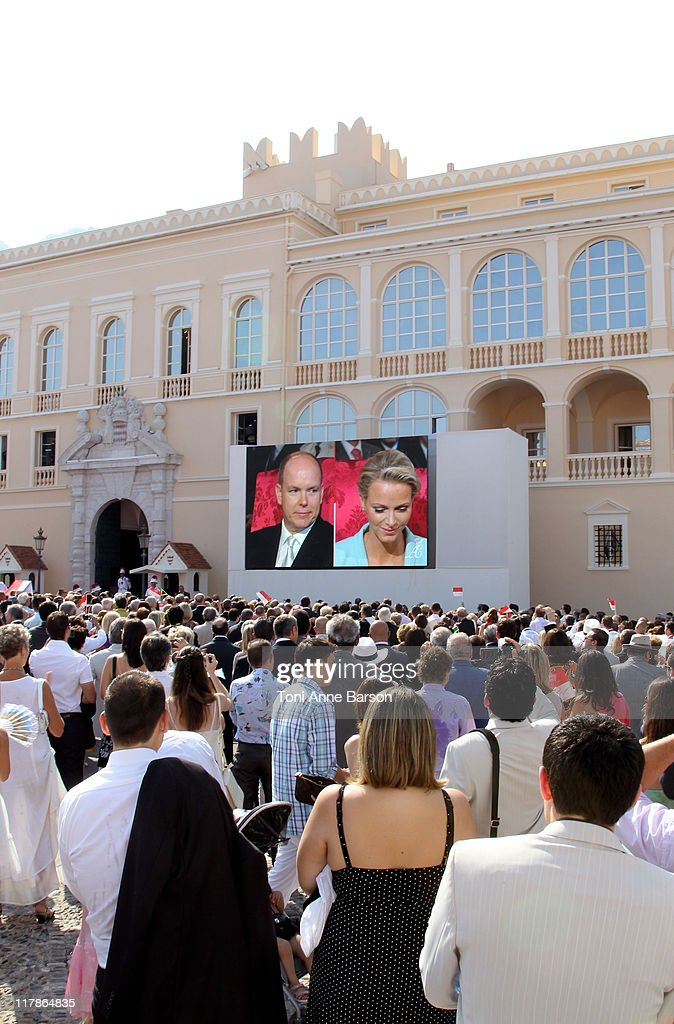 Prince Albert II of Monaco and Charlene Wittstock are seen on a giant screen as the crowd looks on during the civil ceremony of the Royal Wedding of Prince Albert II of Monaco to Charlene Wittstock at the Prince's Palace on July 1, 2011 in Monaco. The ceremony takes place in the Throne Room of the Prince's Palace of Monaco, followed by a religious ceremony to be conducted in the main courtyard of the Palace on July 2. With her marriage to the head of state of Principality of Monaco, Charlene Wittstock will become Princess consort of Monaco and gain the title, Princess Charlene of Monaco. Celebrations including concerts and firework displays are being held across several days, attended by a guest list of global celebrities and heads of state.