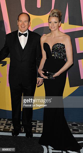 Prince Albert II of Monaco and Charlene Wittstock arrive at the 2009 Monte Carlo Rock' N Rose Ball held at The Sporting Monte Carlo on March 28, 2009...