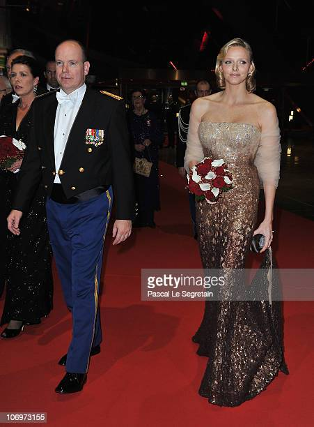 Prince Albert II of Monaco and Charlene Wittstock arrive to attend the Monaco National day Gala concert at Grimaldi forum on November 19, 2010 in...