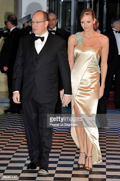 Prince Albert II of Monaco and Charlene Wittstock arrive to attend the Monte Carlo Morocco Rose Ball 2010 held at the Sporting Monte Carlo on March...