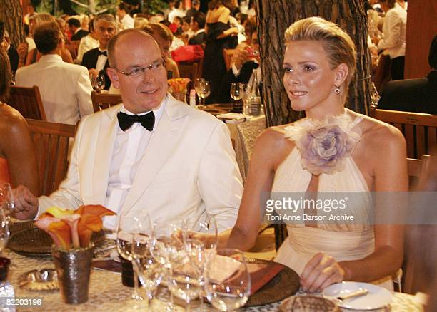 Prince Albert II of Monaco and Charlene Wittstock attend the 60th Monaco Red Cross Ball at the Monte-Carlo Sporting Club on August 1, 2008 in Monte...