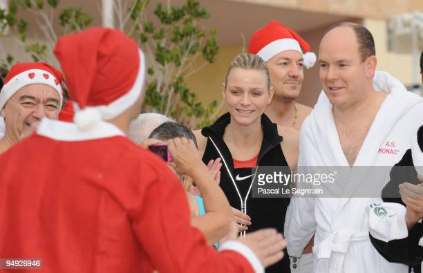 Prince Albert II of Monaco and Charlene Wittstock attend the Annual Charity Christmas Swim for TATSA Association on December 20 2009 in Monaco Monaco
