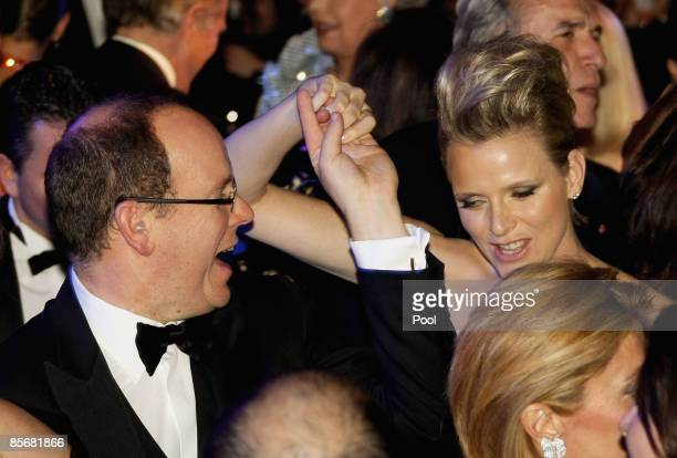 Prince Albert II of Monaco and Charlene Wittstock dance during the 2009 Monte Carlo Rock' N Rose Ball held at The Sporting Monte Carlo on March 28...
