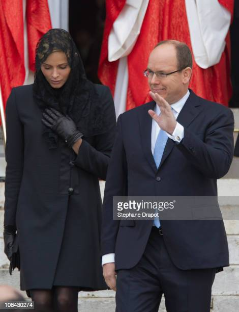 Prince Albert II of Monaco and Charlene Wittstock leave the cathedral after attending mass to celebrate the ceremony of the Sainte Devote on January...