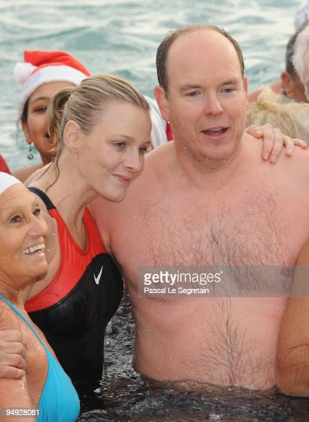 Prince Albert II of Monaco and Charlene Wittstock on his left pose during the Annual Charity Christmas Swim for TATSA Association on December 20 2009...