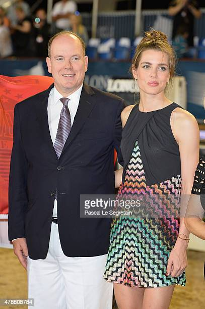 Prince Albert II of Monaco and Charlotte Casiraghi attend the winners ceremony of the Monaco 2015 CSI5* 160m of the Longines Global Champions Tour of...