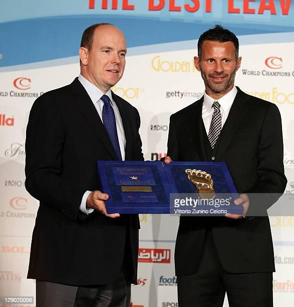 Prince Albert II of Monaco and football legend Ryan Giggs attend the Golden Foot Ceremony Awards on October 10 2011 in Monaco Monaco